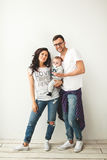 Hipster father, mother holding cute baby boy over white backgrou Stock Photography