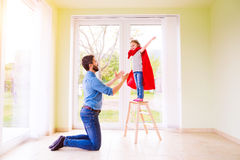 Hipster father with princess daughter jumping into his arms Stock Photos