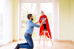 Hipster father with princess daughter jumping into his arms Stock Photography