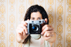 Hipster female photographer taking photo Stock Photography