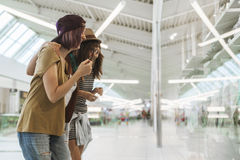 Hipster Females In Shopping Mall. Three Hipster Females In Shopping Mall Royalty Free Stock Photo