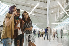 Hipster Females In Shopping Mall Stock Photo
