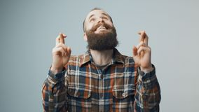 Hipster with fingers crossed for good luck. Hipster bearded man standing with fingers crossed for good luck stock footage
