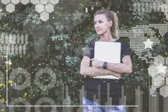 Hipster.In foreground are virtual graphs, diagrams, charts.Girl is waiting for colleague.Online marketing,education. Young hipster businesswoman in black t Stock Image