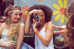 Hipster friends by camper van at festival Royalty Free Stock Photography