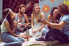 Hipster friends by camper van at festival Royalty Free Stock Photo