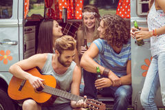 Hipster friends in camper van at festival Stock Images