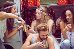 Hipster friends in camper van at festival Royalty Free Stock Image