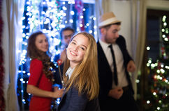 Hipster friends celebrating New Years Eve together, dancing. Royalty Free Stock Photo