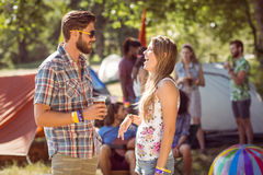Hipster friends chatting on campsite Stock Images