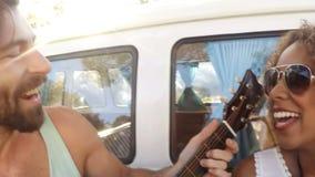 Hipster friends having fun outside camper van stock footage