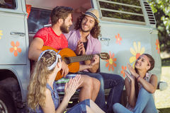 Hipster friends sitting by their camper van Royalty Free Stock Photo