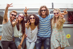 Hipster friends smiling at camera stock photo