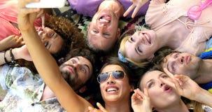 Hipster friends taking a selfie lying