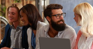 Hipster friends talking and using laptop. In a cafe stock footage
