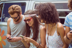 Hipster Friends Using Their Phones Royalty Free Stock Photo