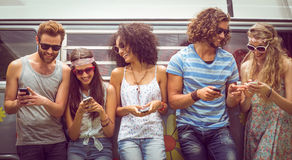 Hipster friends using their phones Stock Images