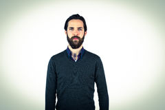 Hipster frowning at camera. On vignette background Royalty Free Stock Photo