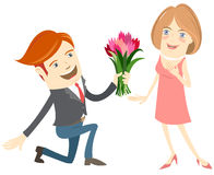 Hipster funny man kneeling giving flowers to the smiling woman. Royalty Free Stock Photo