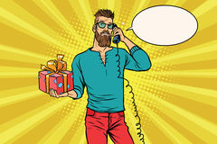 Hipster with a gift of talking on the phone Royalty Free Stock Photography