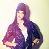 Hipster girl with beanie hat showing attitude royalty free stock photography