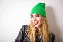 Hipster Girl in Beanie Hat on White Background Stock Photos