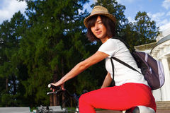Hipster girl on a bicycle Royalty Free Stock Images