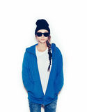 Hipster girl in blue hoodie and black beanie Stock Images