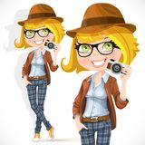 Hipster girl with a camera Stock Images