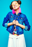 Hipster girl in casual colorful summer clothes in studio Stock Photography