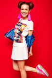 Hipster girl in casual colorful summer clothes in studio Royalty Free Stock Photography
