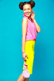 Hipster girl in casual colorful summer clothes in studio Stock Images