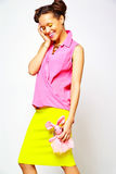 Hipster girl in casual colorful summer clothes in studio Royalty Free Stock Photo
