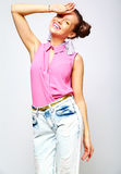 Hipster girl in casual colorful summer clothes in studio Stock Photos