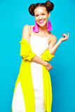 Hipster girl in casual colorful summer clothes in studio Stock Image
