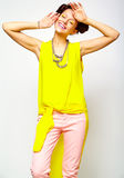Hipster girl in casual colorful summer clothes in studio Royalty Free Stock Photos