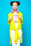 Hipster girl in casual colorful summer clothes in studio Royalty Free Stock Images