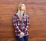 Hipster girl in checkered shirt posing Stock Images