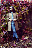 Hipster girl in a coat stock images