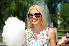 Hipster girl with cotton candy Royalty Free Stock Photo