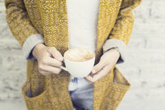 Hipster girl with cup of cappuccino Royalty Free Stock Photos