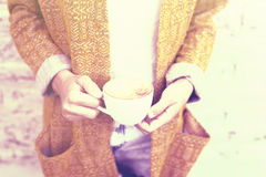 Hipster girl with cup of coffee in hands Royalty Free Stock Images