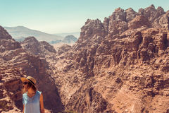 Hipster girl enjoy vacation and journey to Jordan. Gorgeous view from Petra. Negative space for text. Tourism industry. Active lif Royalty Free Stock Images