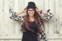 Hipster girl in glasses and black beanie Royalty Free Stock Images