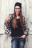 Hipster girl in glasses and black beanie with thumbs up Royalty Free Stock Photo
