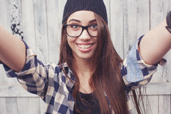 Hipster girl in glasses and black beanie Royalty Free Stock Image