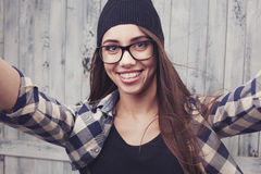 Hipster girl in glasses and braces Royalty Free Stock Photo
