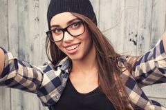 Hipster girl in glasses and braces Stock Photo