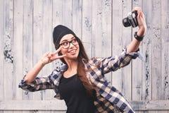 Hipster girl in glasses making selfie Stock Photo