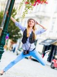 Hipster girl having fun on city street Royalty Free Stock Photo